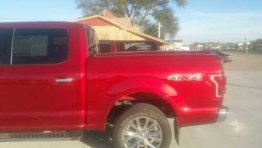 Used Lid - 2015-2018 Ford F-150 5.5 ft bed - Red (Image 1)
